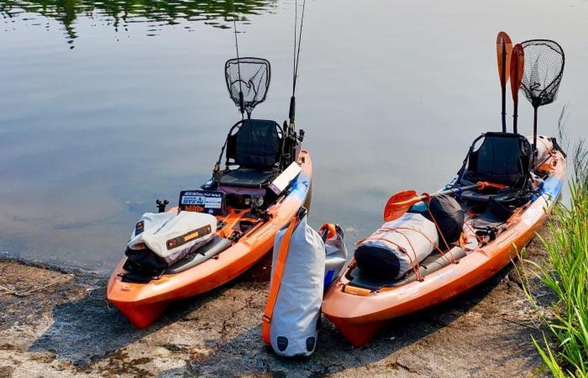 Two heavily loaded fishing kayaks