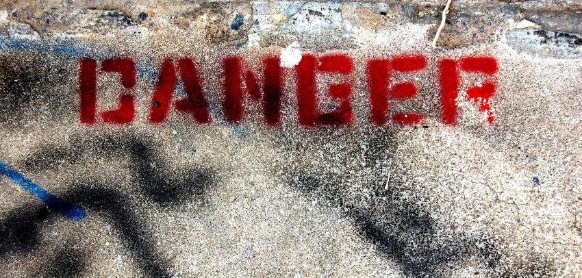 Danger caption on the sand