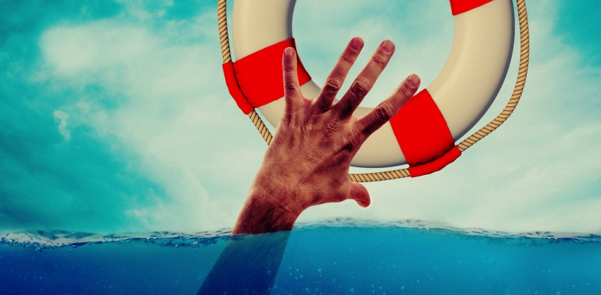 A hand of a drowning man and a lifebuoy