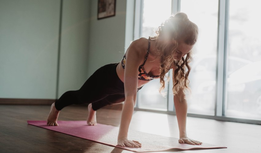 A girl doing a plank at home