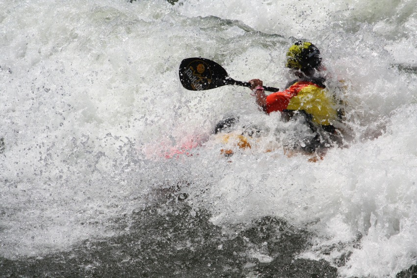 Kayak captured by whitewater