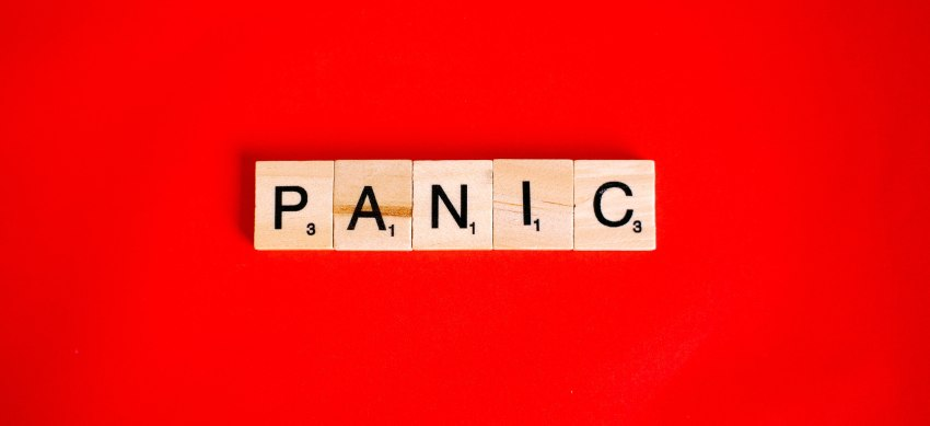 'Panic' word compiled from wooden ABC blocks