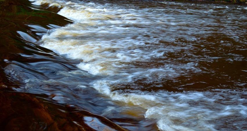 Water running through a weir